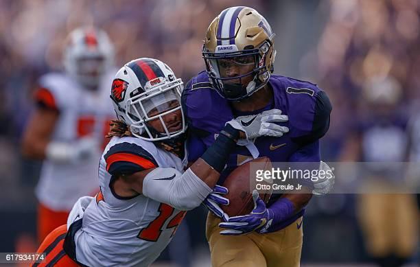 Wide receiver John Ross of the Washington Huskies rushes against cornerback Treston Decoud of the Oregon State Beavers on October 22 2016 at Husky...