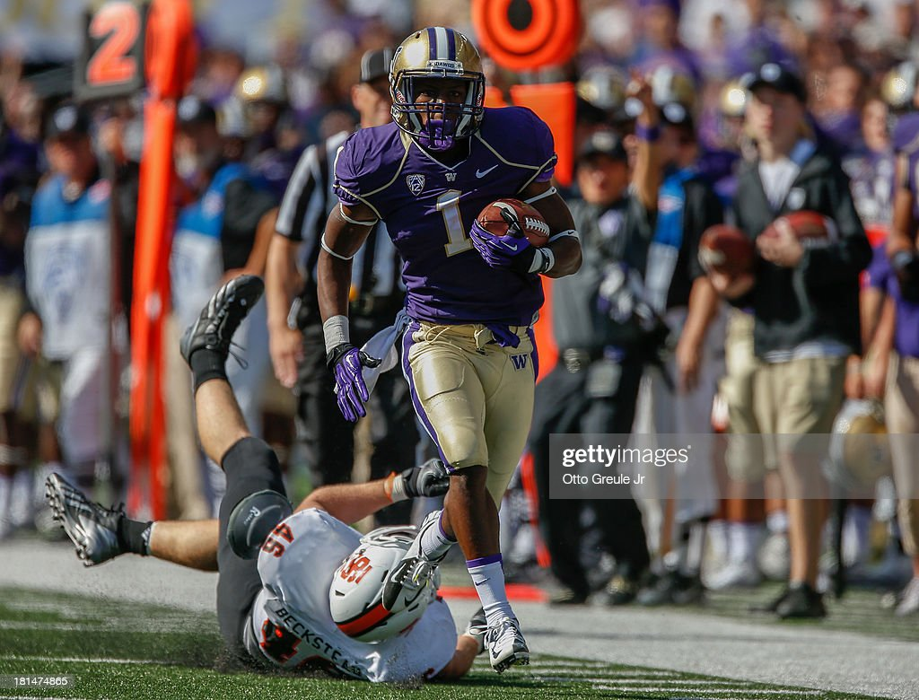 Wide receiver John Ross #1 of the Washington Huskies rushes for a 57 yard touchdown in the second half against the Idaho State Bengals on September 21, 2013 at Husky Stadium in Seattle, Washington. The Huskies the Bengals 56-0.
