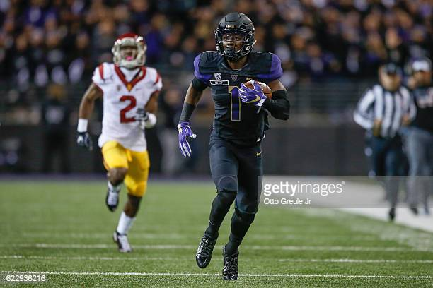 Wide receiver John Ross of the Washington Huskies rushes for a touchdown against the USC Trojans on November 12 2016 at Husky Stadium in Seattle...