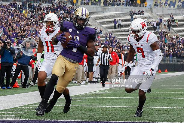 Wide receiver John Ross of the Washington Huskies scores a touchdown against the Rutgers Scarlet Knights on September 3 2016 at Husky Stadium in...