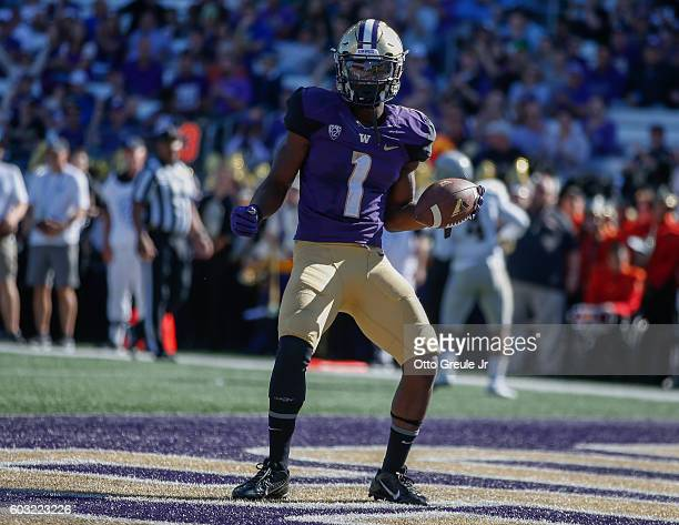 Wide receiver John Ross of the Washington Huskies scores a touchdown in the second quarter against the Idaho Vandals on September 10 2016 at Husky...