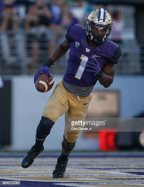 Wide receiver John Ross of the Washington Huskies scores a touchdown against the Idaho Vandals in the third quarter on September 10 2016 at Husky...