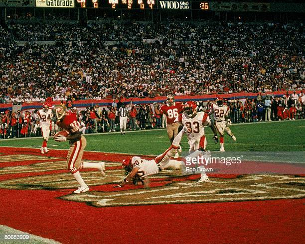 Wide receiver John Taylor of the San Francisco 49ers catches the gamewinning touchdown pass against the Cincinnati Bengals in Super Bowl XXIII at Joe...