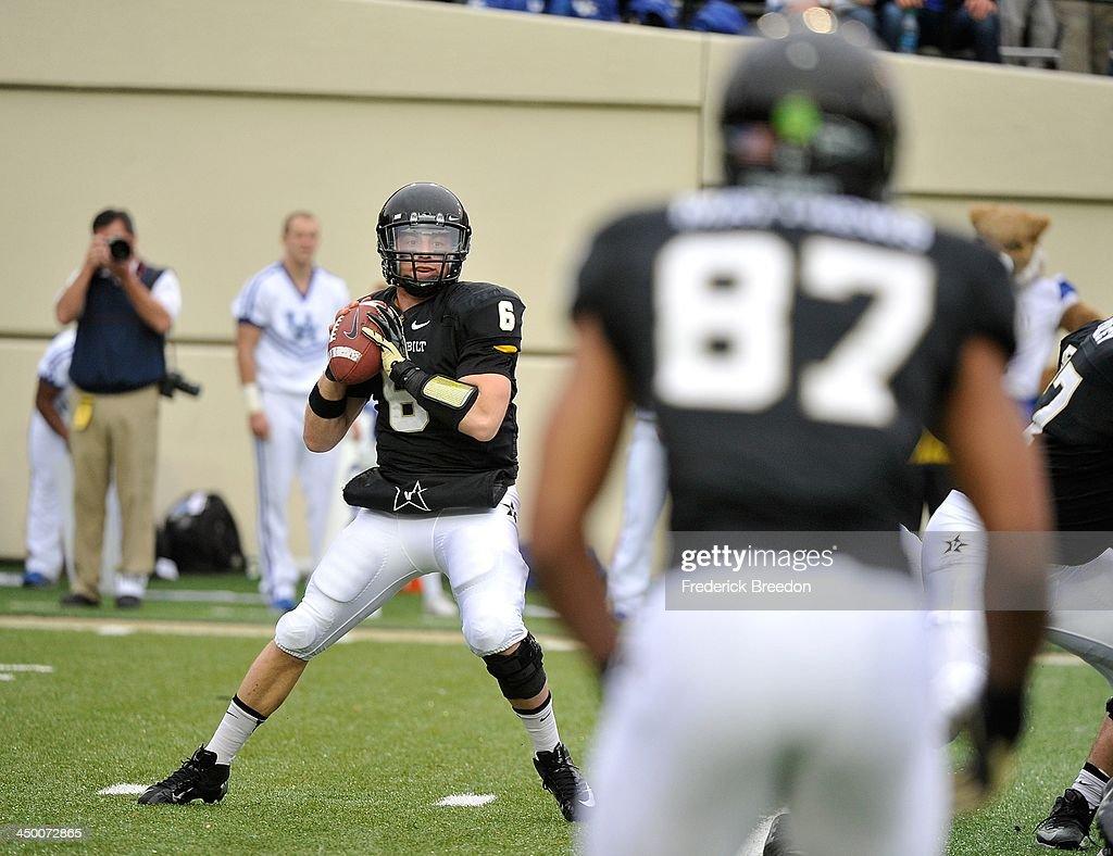 Wide receiver Jordan Matthews #87 watches as quarterback Austyn Carta-Samuels #6 of the Vanderbilt Commodores drops back to throw a pass against the Kentucky Wildcats at Vanderbilt Stadium on November 16, 2013 in Nashville, Tennessee.
