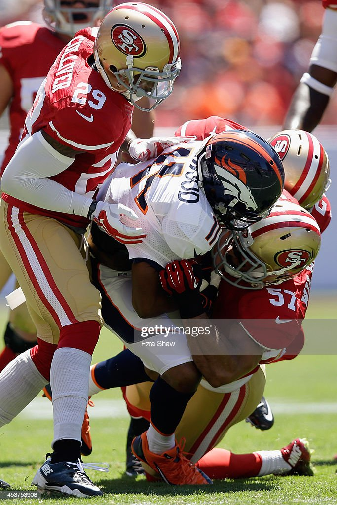 Wide receiver <a gi-track='captionPersonalityLinkClicked' href=/galleries/search?phrase=Jordan+Norwood&family=editorial&specificpeople=2089416 ng-click='$event.stopPropagation()'>Jordan Norwood</a> #11 of the Denver Broncos gets hit by inside linebacker <a gi-track='captionPersonalityLinkClicked' href=/galleries/search?phrase=Michael+Wilhoite&family=editorial&specificpeople=9205641 ng-click='$event.stopPropagation()'>Michael Wilhoite</a> #57 and defensive back <a gi-track='captionPersonalityLinkClicked' href=/galleries/search?phrase=Chris+Culliver&family=editorial&specificpeople=4483946 ng-click='$event.stopPropagation()'>Chris Culliver</a> #29 of the San Francisco 49ers during a preseason game at Levi's Stadium on August 17, 2014 in Santa Clara, California.
