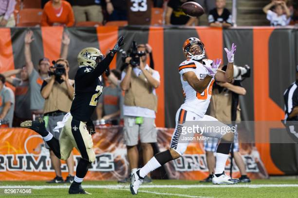 Wide receiver Jordan Payton of the Cleveland Browns catches a touchdown pass while under pressure from cornerback Damian Swann of the New Orleans...
