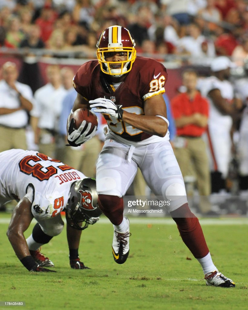 Wide receiver Jordan Reed #86 of the Washington Redskins runs upfield with a pass against the Tampa Bay Buccaneers August 29, 2013 at Raymond James Stadium in Tampa, Florida.
