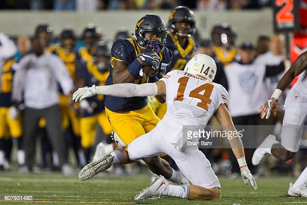 Wide receiver Jordan Veasy of the California Golden Bears slips around safety Dylan Haines of the Texas Longhorns for a 30yard gain in the fourth...