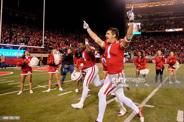 Wide receiver Jordan Westerkamp and quarterback Tommy Armstrong Jr #4 of the Nebraska Cornhuskers celebrate after defeating the Michigan State...