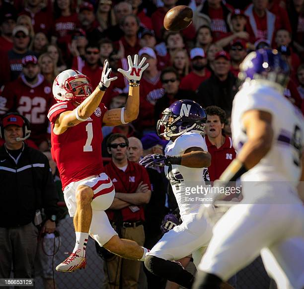 Wide receiver Jordan Westerkamp of the Nebraska Cornhuskers catches a pass over safety Ibraheim Campbell of the Northwestern Wildcats during their...