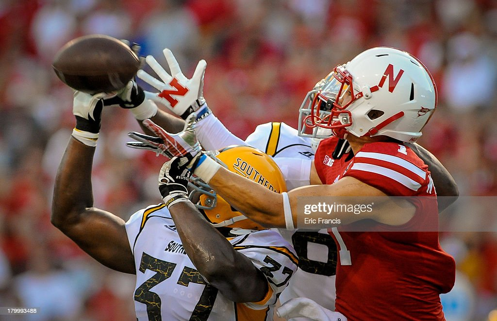 Wide receiver Jordan Westerkamp #1 of the Nebraska Cornhuskers has a pass knocked away by linebacker Alan Howze #37 of the Southern Miss Golden Eagles during their game at Memorial Stadium on September 7, 2013 in Lincoln, Nebraska. Nebraska defeated Southern Miss 56-13.