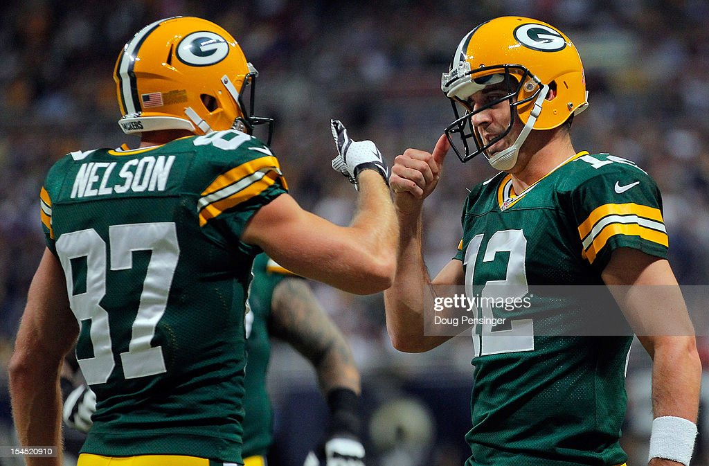 Wide receiver Jordy Nelson of the Green Bay Packers and quarterback Aaron Rodgers of the Green Bay Packers celebrate their three yard touchdown...