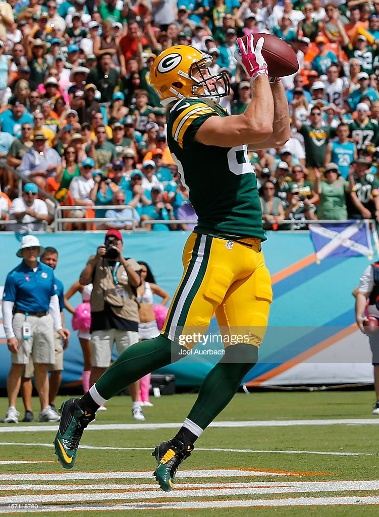 Wide receiver Jordy Nelson of the Green Bay Packers catches a first quarter touchdown pass during a game against the Miami Dolphins at Sun Life...