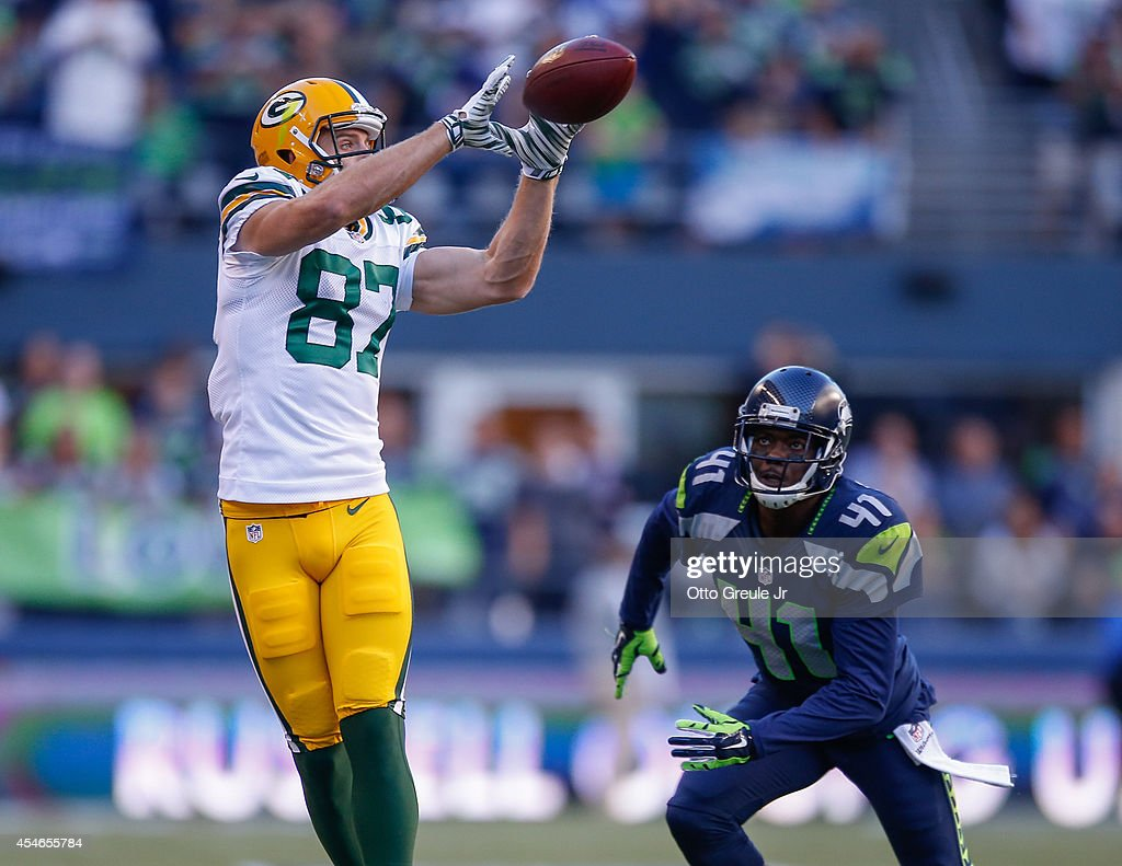 Wide receiver Jordy Nelson of the Green Bay Packers makes a catch against defensive back Byron Maxwell of the Seattle Seahawks at CenturyLink Field...