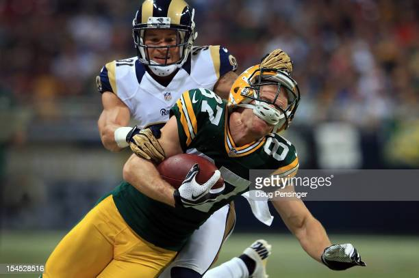 Wide receiver Jordy Nelson of the Green Bay Packers makes a nine yard pass reception as cornerback Cortland Finnegan of the St Louis Rams is...