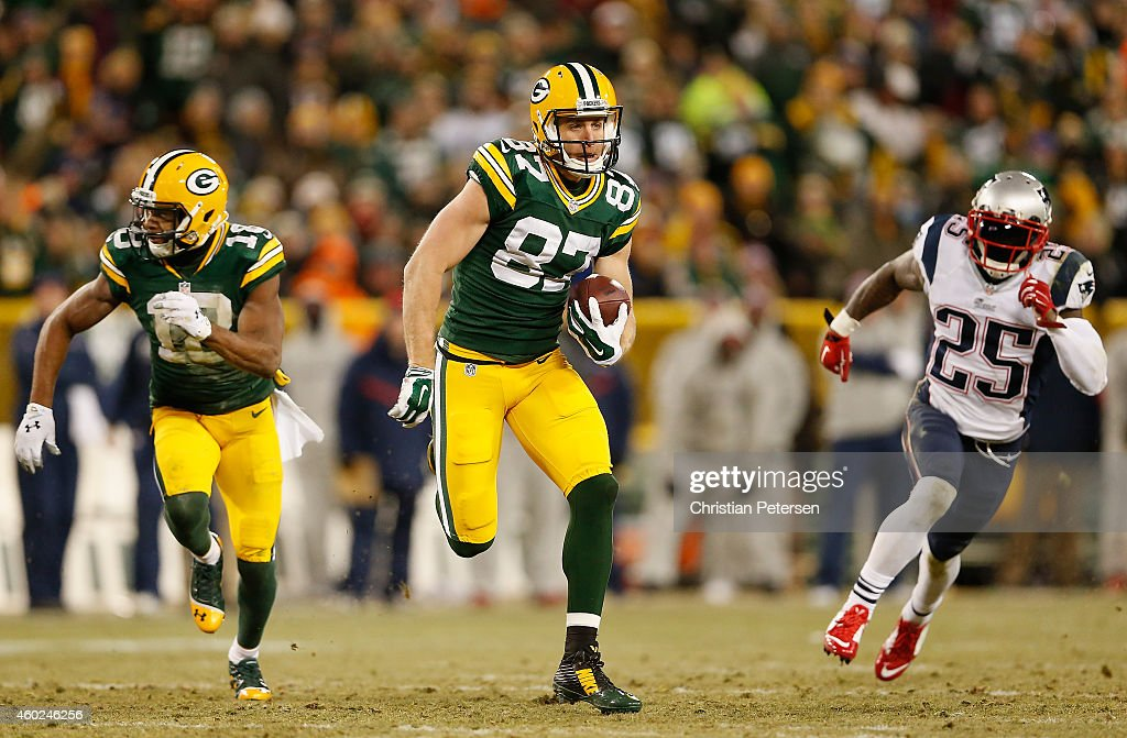 Wide receiver Jordy Nelson of the Green Bay Packers runs with the football en route to scoring on a 45 yard touchdown reception against the New...
