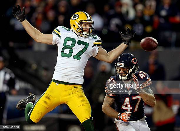 Wide receiver Jordy Nelson of the Green Bay Packers tries to make a catch as free safety Chris Conte of the Chicago Bears defends during a game at...