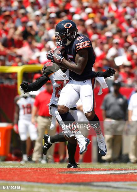 Wide receiver Josh Bellamy of the Chicago Bears hauls in an 11yard pass from quarterback Mike Glennon in front of cornerback Vernon Hargreaves of the...