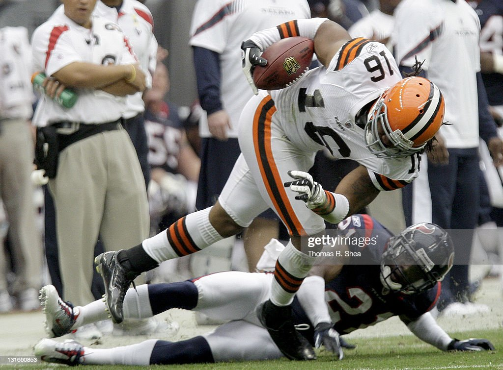 Wide receiver Josh Cribbs #16 of the Cleveland Browns breaks the tackle of cornerback Brice McCain #21 of the Houston Texans on November 6, 2011 at Reliant Stadium in Houston, Texas.