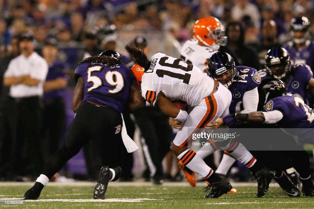 Wide receiver Josh Cribbs #16 of the Cleveland Browns gets hit by linebacker Dannell Ellerbe #59 of the Baltimore Ravens after a play in the first quarter during the NFL Game at M&T Bank Stadium on September 27, 2012 in Baltimore, Maryland.