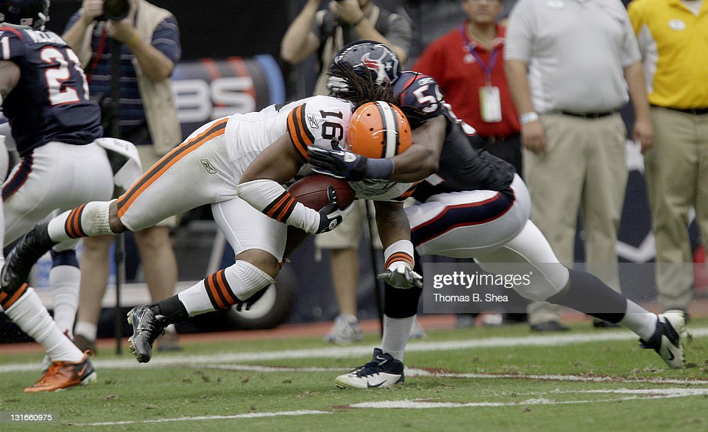 Wide receiver Josh Cribbs #16 of the Cleveland Browns is tackled by linebacker Brooks Reed #58 of the Houston Texans on November 6, 2011 at Reliant Stadium in Houston, Texas.