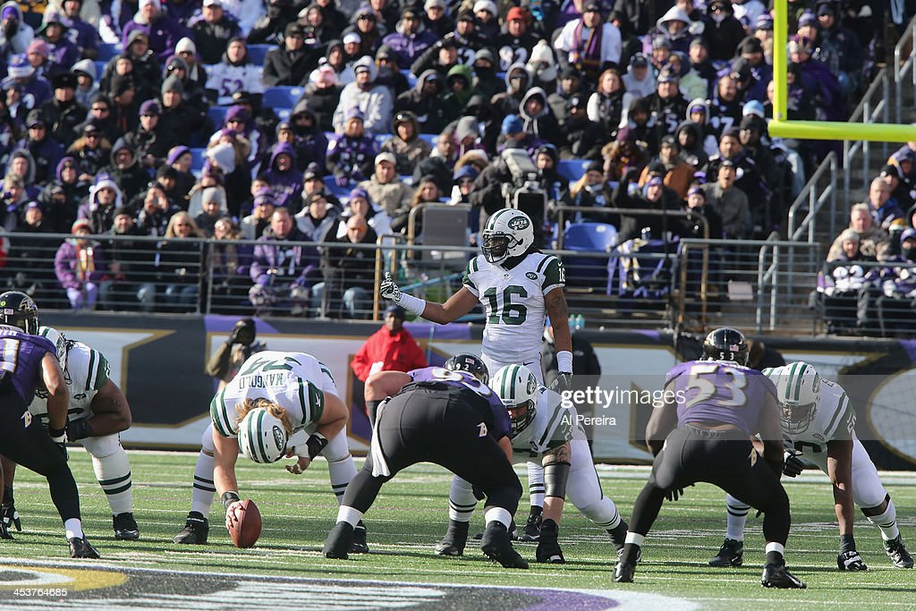 Wide Receiver Josh Cribbs of the New York Jets calls a play out of the Wildcat against the Baltimore Ravens at MT Bank Stadium on November 24 2013 in...
