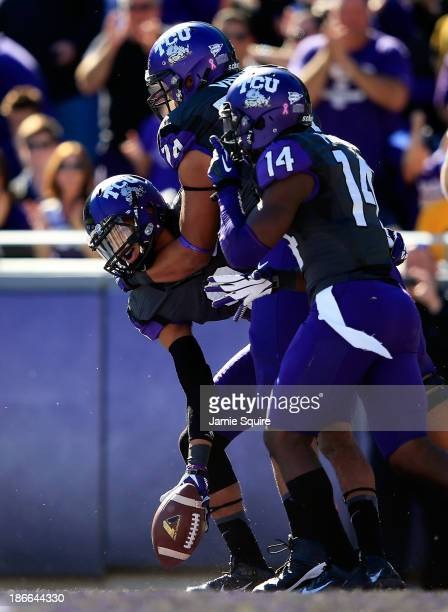 Wide receiver Josh Doctson of the TCU Horned Frogs is congratulated by offensive tackle Halapoulivaati Vaitai and wide receiver David Porter after...