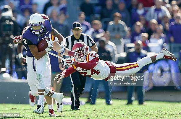 Wide receiver Josh Doctson of the TCU Horned Frogs runs with the football after a reception past defensive back Nigel Tribune of the Iowa State...