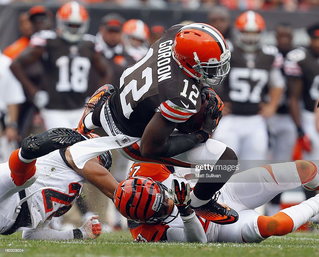 Wide receiver Josh Gordon #12 of the Cleveland Browns dives over cornerbacks <a gi-track='captionPersonalityLinkClicked' href=/galleries/search?phrase=Leon+Hall&family=editorial&specificpeople=223989 ng-click='$event.stopPropagation()'>Leon Hall</a> #29 and <a gi-track='captionPersonalityLinkClicked' href=/galleries/search?phrase=Terence+Newman&family=editorial&specificpeople=220965 ng-click='$event.stopPropagation()'>Terence Newman</a> #23 of the Cincinnati Bengals at FirstEnergy Stadium on September 29, 2013 in Cleveland, Ohio.