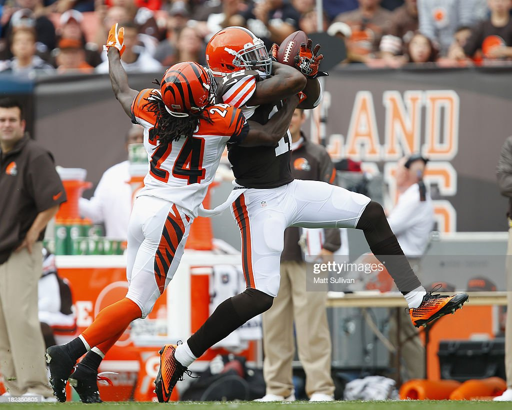 Wide receiver Josh Gordon #12 of the Cleveland Browns makes catch over cornerback Adam Jones #24 of the Cincinnati Bengals at FirstEnergy Stadium on September 29, 2013 in Cleveland, Ohio.