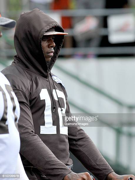 Wide receiver Josh Gordon of the Cleveland Browns stretches on the sideline during training camp on August 9 2016 at the Cleveland Browns training...
