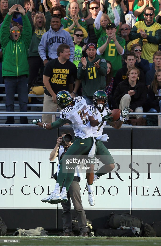 Wide receiver Josh Huff #1 of the Oregon Ducks cellebrates his touchdown reception with wide receiver Daryle Hawkins #16 of the Oregon Ducks against the Colorado Buffaloes as the fans join in at Folsom Field on October 5, 2013 in Boulder, Colorado. The Ducks defeated the Buffs 57-16.