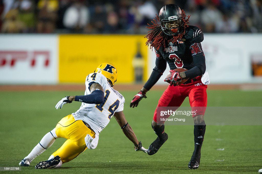 Wide receiver Josh Jarboe #3 of the Arkansas State Red Wolves maneuvers past cornerback Dylan Farrington #14 of the Kent State Golden Flashes on January 6, 2013 at Ladd-Peebles Stadium in Mobile, Alabama. Arkansas State defeated Kent State 17-13.