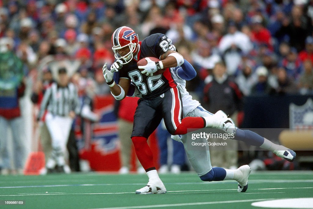 Wide receiver Josh Reed of the Buffalo Bills tries runs with the football after catching a pass during a game against the Detroit Lions at Ralph...