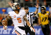 Wide receiver Josh Stewart of the Oklahoma State Cowboys scores a touchdown on a 40yard catch in the first half while taking on the Missouri Tigers...