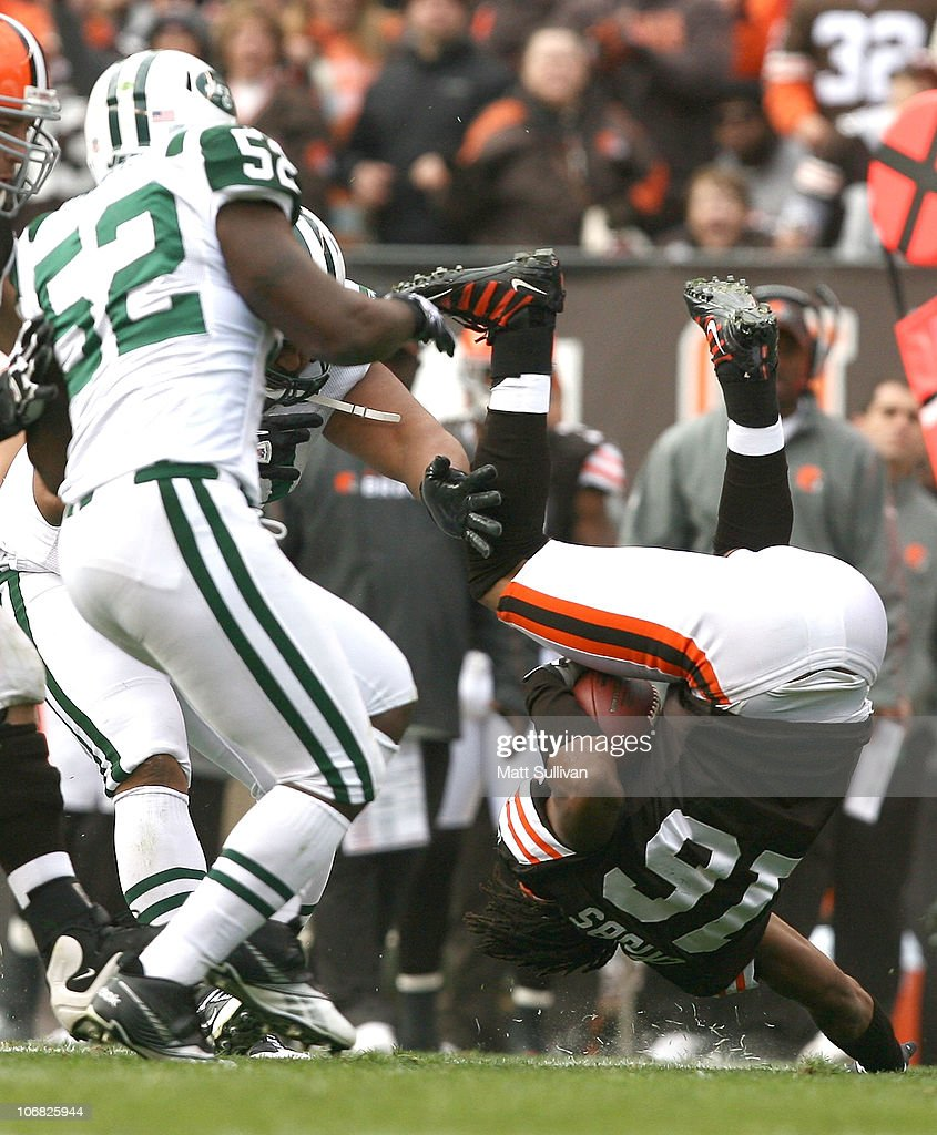 Wide receiver Joshua Cribbs of the Cleveland Browns flips over as he is hit by linebacker David Harris of the New York Jets at Cleveland Browns...