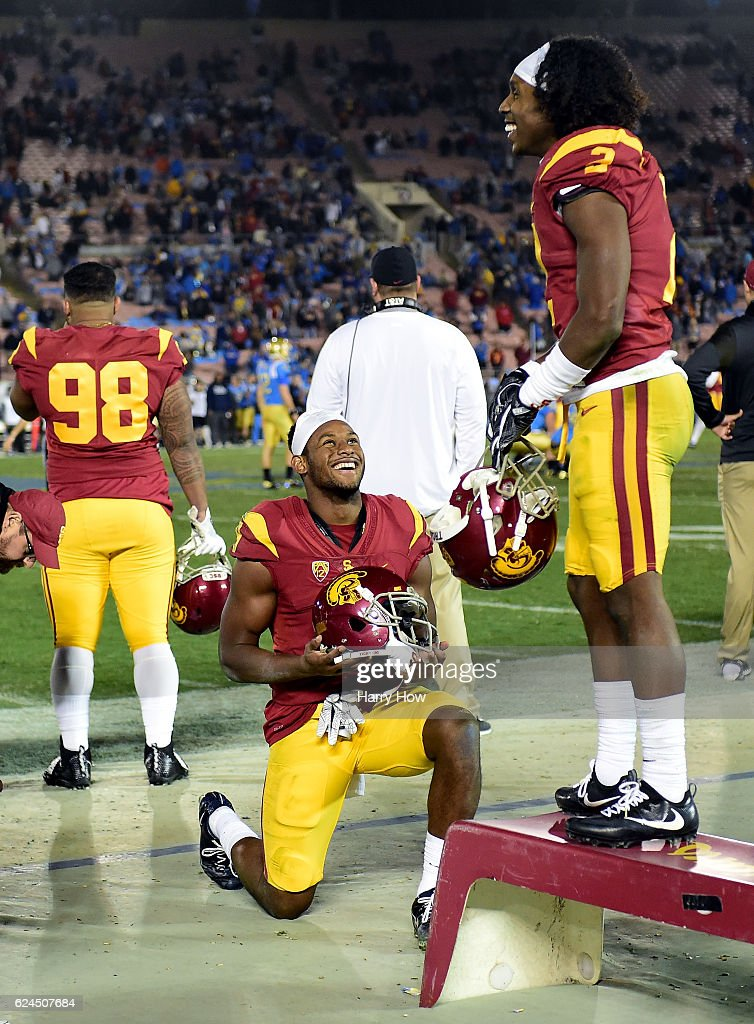 Wide receiver JuJu Smith-Schuster #9 and defensive back Adoree' Jackson #2 of the USC Trojans laugh on the sidelines during a 36-14 win over the UCLA Bruins at Rose Bowl on November 19, 2016 in Pasadena, California.