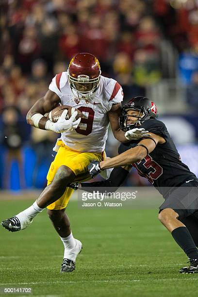 Wide receiver JuJu SmithSchuster of the USC Trojans breaks a tackle form cornerback Alijah Holder of the Stanford Cardinal during the third quarter...