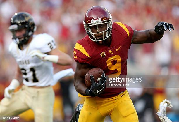 Wide receiver JuJu SmithSchuster of the USC Trojans carries the ball into the zone on a 50 yard touchdown pass play in tthe first quarter against the...