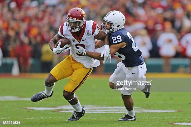 Wide receiver JuJu SmithSchuster of the USC Trojans carries the ball against Corner back John Reid of the Penn State Nittany Lions in the 2017 Rose...