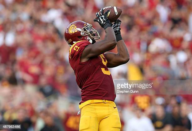Wide receiver JuJu SmithSchuster of the USC Trojans catches the ball before carrying it into the zone on a 50 yard touchdown pass play in tthe first...