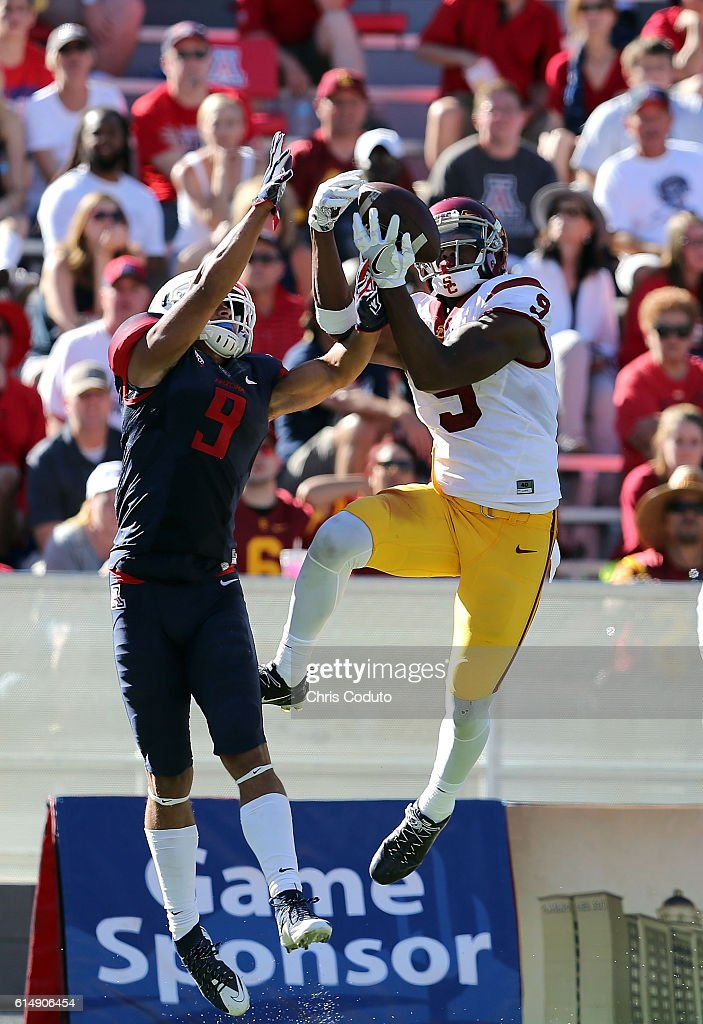 Wide receiver JuJu Smith-Schuster #9 of the USC Trojans hauls in a touchdown pass over cornerback Dane Cruikshank #9 of the Arizona Wildcats during the third quarter of the college football game against at Arizona Stadium on October 15, 2016 in Tucson, Arizona. USC won 48-14.