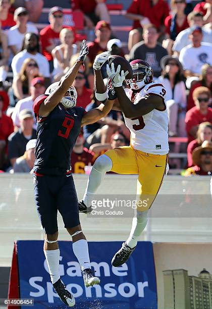 Wide receiver JuJu SmithSchuster of the USC Trojans hauls in a touchdown pass over cornerback Dane Cruikshank of the Arizona Wildcats during the...
