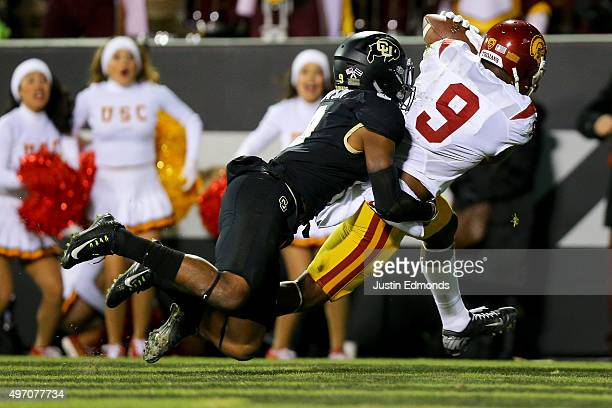 Wide receiver JuJu SmithSchuster of the USC Trojans makes a catch for what would end up being the gamewinning score against defensive back Tedric...