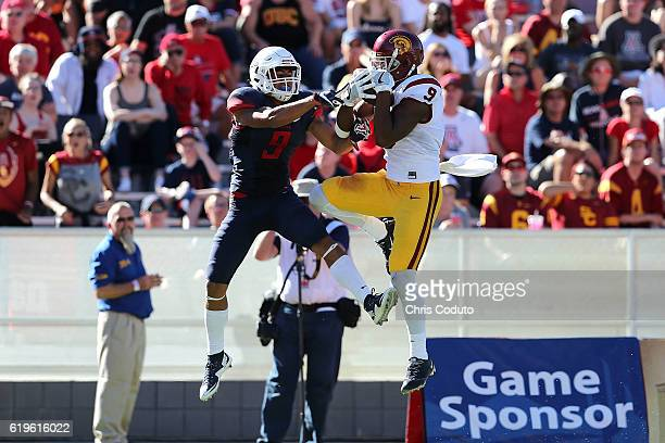 Wide receiver JuJu SmithSchuster of the USC Trojans makes a catch for a touchdown pass over cornerback Dane Cruikshank of the Arizona Wildcats during...