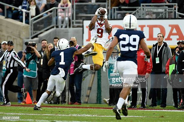 Wide receiver JuJu SmithSchuster of the USC Trojans makes a reception against cornerback Christian Campbell of the Penn State Nittany Lions in the...