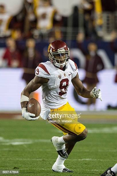 Wide receiver JuJu SmithSchuster of the USC Trojans rushes up field against the Stanford Cardinal during the fourth quarter of the Pac12 Championship...