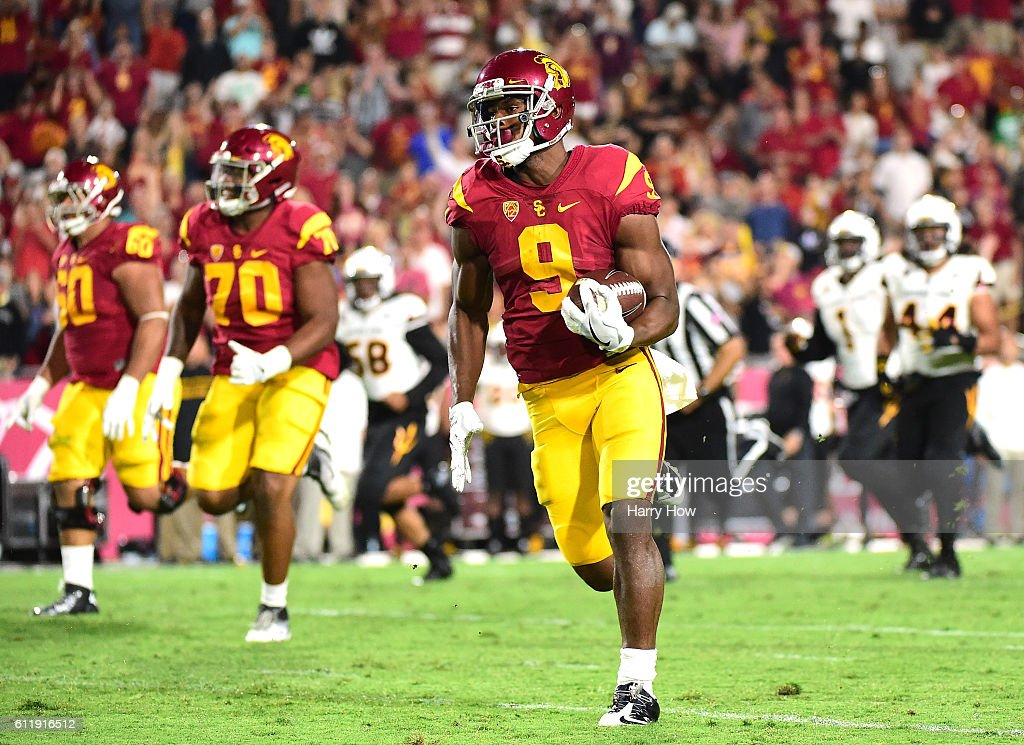 Wide receiver JuJu Smith-Schuster #9 of the USC Trojans scores a 67 yard touchodwn, for his third touchdown of the game over the Arizona State Sun Devils during the third quarter at Los Angeles Coliseum on October 1, 2016 in Los Angeles, California.