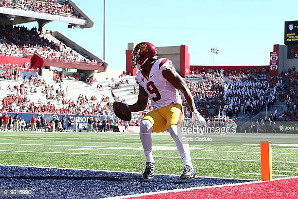 Wide receiver JuJu SmithSchuster of the USC Trojans scores a touchdown during the first half of the college football game against the Arizona...
