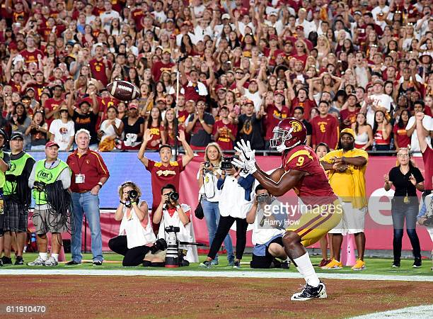Wide receiver JuJu SmithSchuster of the USC Trojans waits alone in the end zone as he makes a catch for a touchdown to take a 176 lead over the...